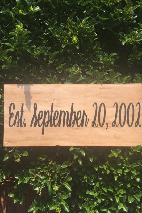 Est. date hand painted wood sign.