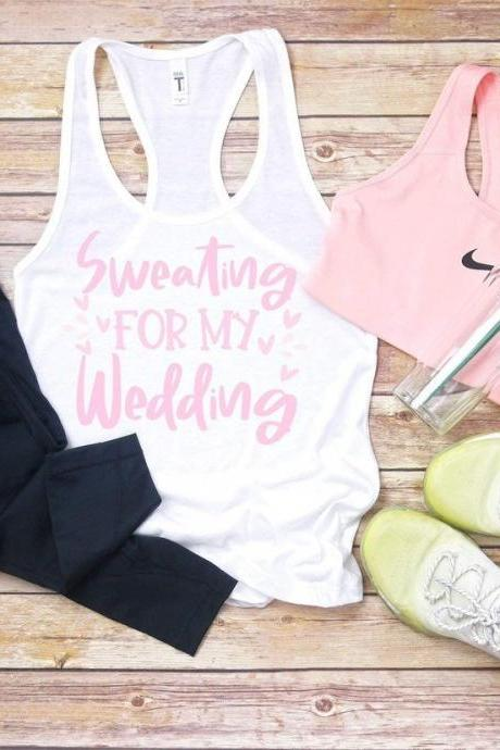 Sweating for my wedding . Ladies next level tank. Work out tank. Gym shirt