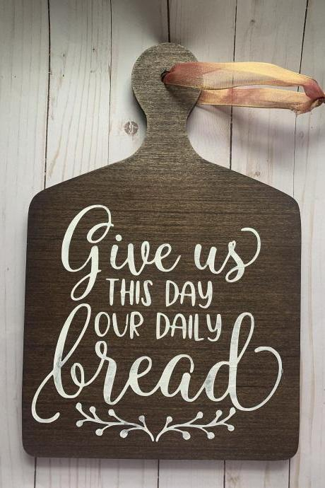 Give us this day our daily bread. Wood decorative cutting board. 12x14 Inches