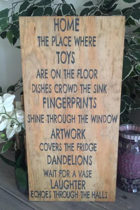 Home the place where toys are on the floor... 12x24 hand painted stained wood sign.
