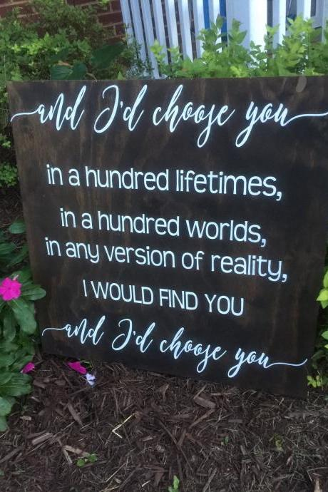 And I'd choose you In a hundred lifetimes in a hundred worlds any version of reality I would find you and I'd choose you hand painted sign